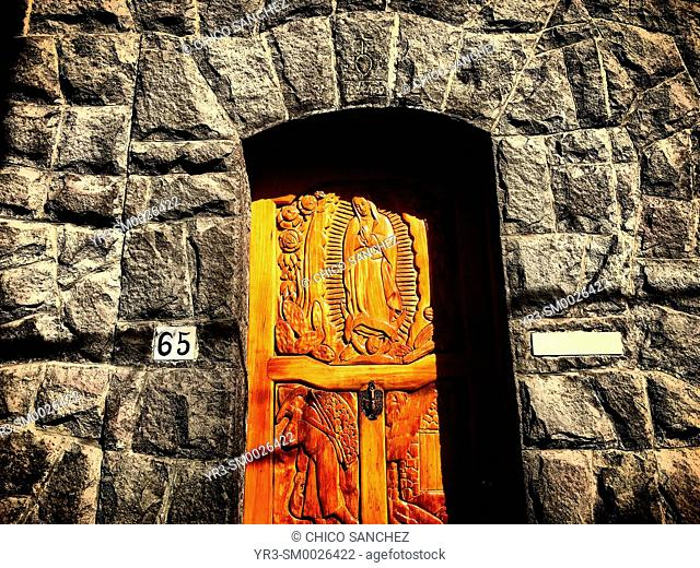 A door decorated with an image of Our Lady of Guadalupe decorates a home in Coyoacan, Mexico