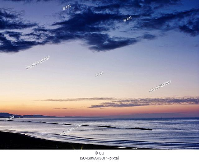 View of coast at sunset, Pescara, Abruzzo, Italy