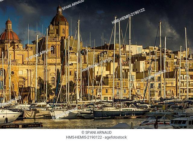 Malta, Birgu, Vittoriosa, general view of a yacht marina and a Mediterranean city at sunset
