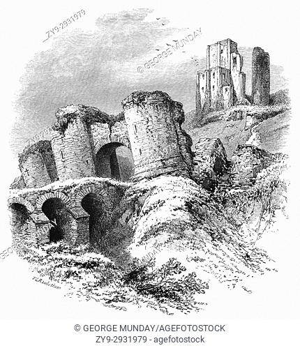 1870: The 10th Century ruins of Corfe Castle that stands above the village of the same name. It was the site of the murder of Edward the Martyr in 978