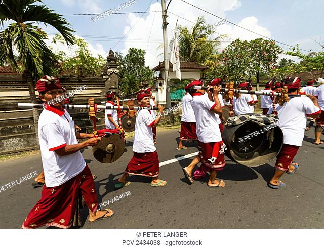 Gamelan orchestra in a ceremonial procession, Baha, Bali, Indonesia