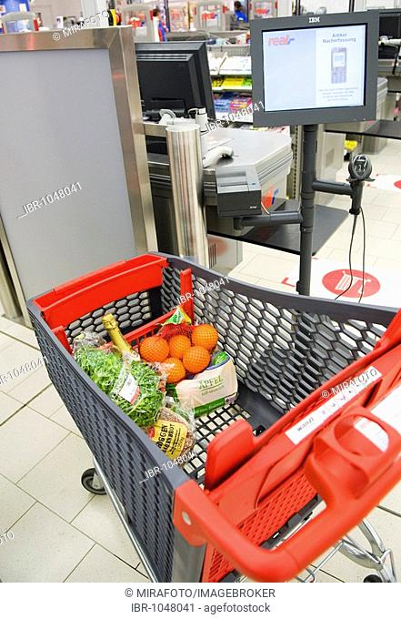 Two detectors scanning the content of a shopping cart with RFID technology in the real, - Future Store, part of the Metro Group, in Toenisvorst near Krefeld