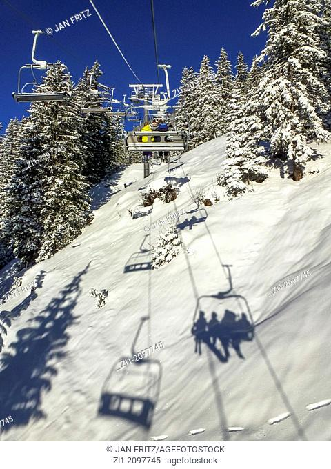 skilift and shadows at snow in Flaine, France