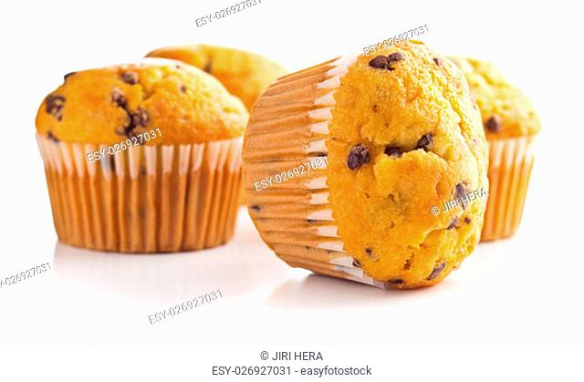 The tasty muffins with chocolate isolated on white background