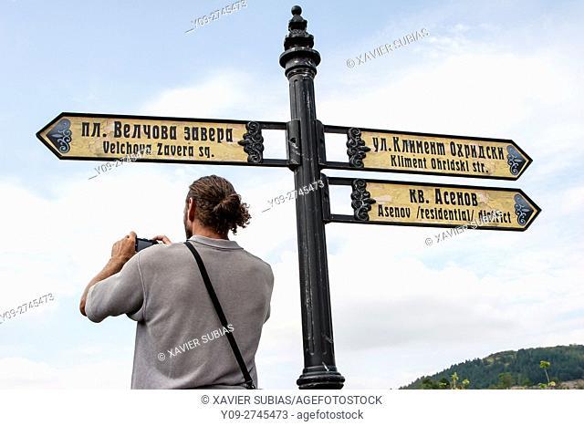 Man take a photo and pedestrian signs, Veliko Tarnovo, Bulgaria