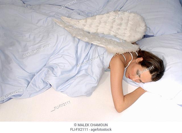 Woman Sleeping with Angel Wings