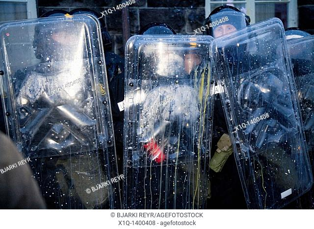 Protests continued on wednesday 21/01/2009, Police protects Parliament building  Demonstrators are demanding that the government step down and to have a...