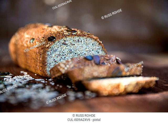 Fresh sliced seeded gluten free loaf on table
