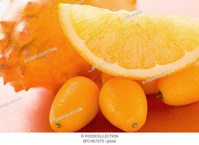 Kiwano, kumquats and wedge of orange