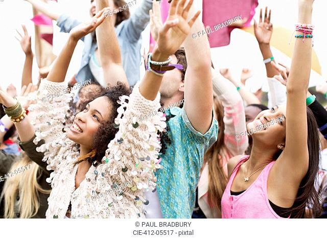 Fans cheering at music festival