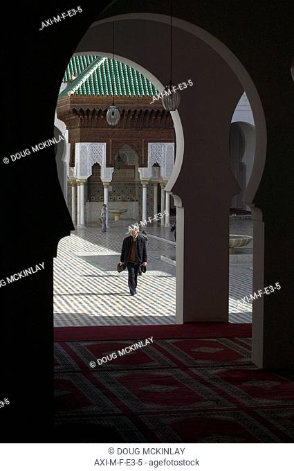 Man walking in Kairaouine Mosque, dating from AD 857, Fes, Morocco