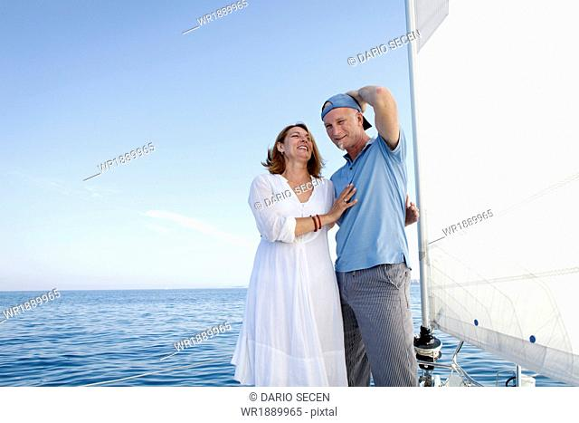 Mature couple on sailboat, having fun, Adriatic Sea, Croatia