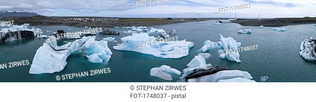 Panoramic view of icebergs in water against sky, Jökulsárlón, Iceland