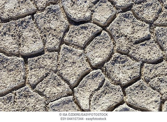 Top view of Cracked earth soil texture background. Salt desert cracks on ground with light color
