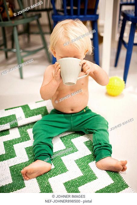 Small boy having a cup of tea, Sweden
