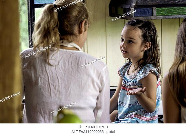 Girl talking with her grandmother