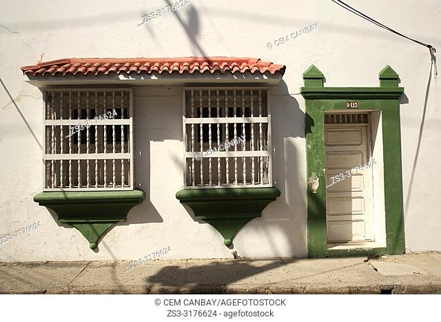 View to the door and windows of a colonial building at the historic center, Cartagena de Indias, Bolivar, Colombia, South America