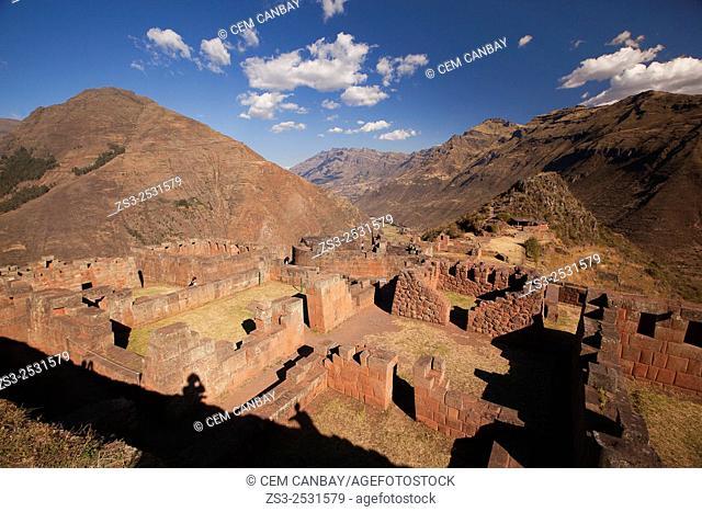 Tourists near the Inca terraces of the ancient Inca settlement, Pisac Ruins , Cusco Region, Peru, South America