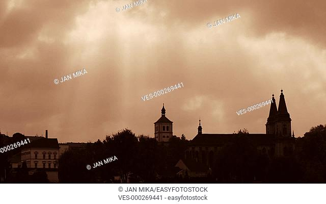Dramatic sky and silhouette of cityscape with ancient architecture of town Roudnice nad Labem in the Czech Republic