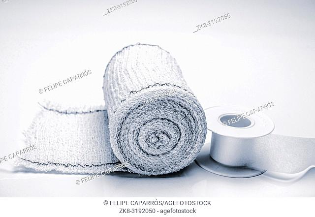 Bandage roll and isolated plaster on white background, conceptual image