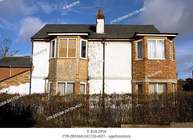 Derelict semi detached Council houses waiting demolition, East London, England, UK
