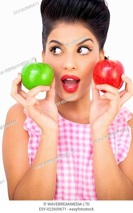 Surprised black hair model holding apples