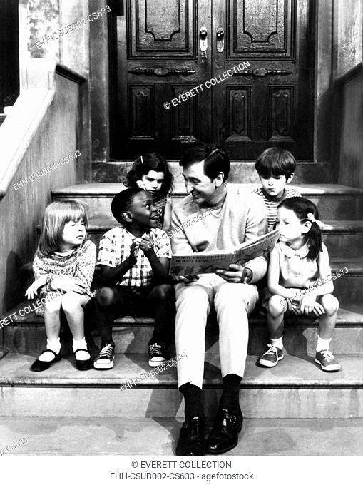 Robert Emmet McGrath, as character Bob Johnson, reading to children on SESEME STREET, 1970. (CSU-2015-11-1678)