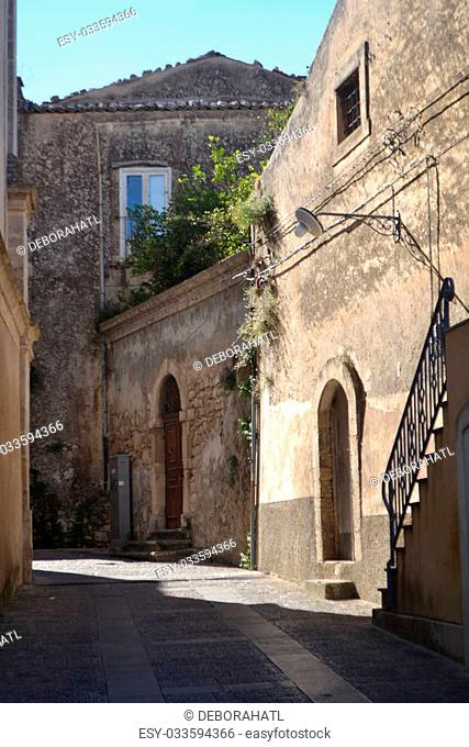 Typical narrow streets of Ragusa Ibla in Sicily Italy