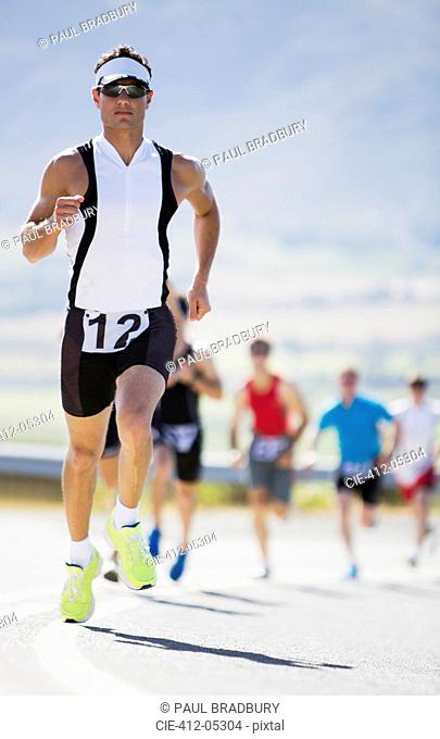 Runner in race on rural road