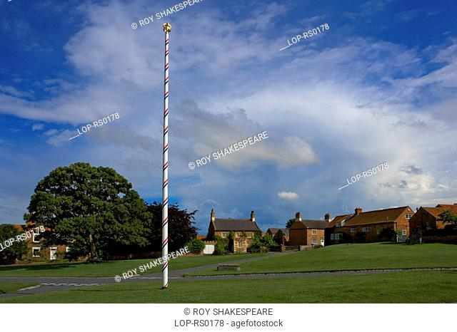 England, North Yorkshire, Aldborough, Traditional maypole on the village green. Aldborough is built on the foundations of a major Roman city