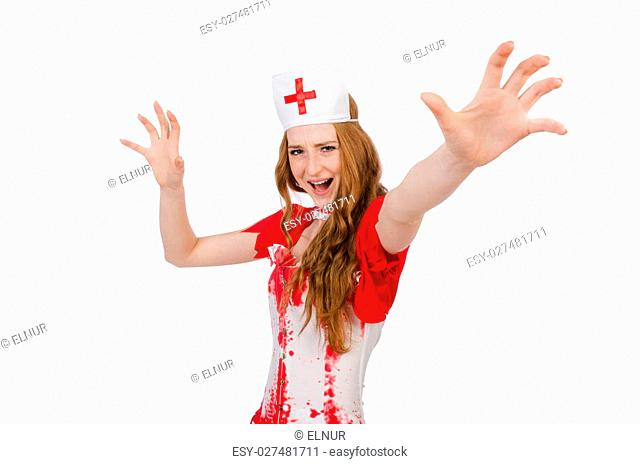 Woman doctor covered in blood in halloween concept