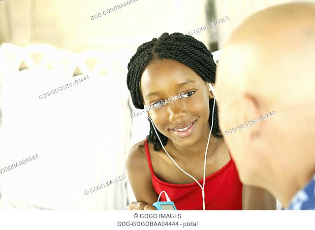 Young African girl talking to older Caucasian man