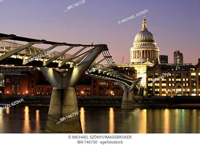 Millennium Bridge and St. Paul's Cathedral seen from the southern bank of the Thames, London, England, UK