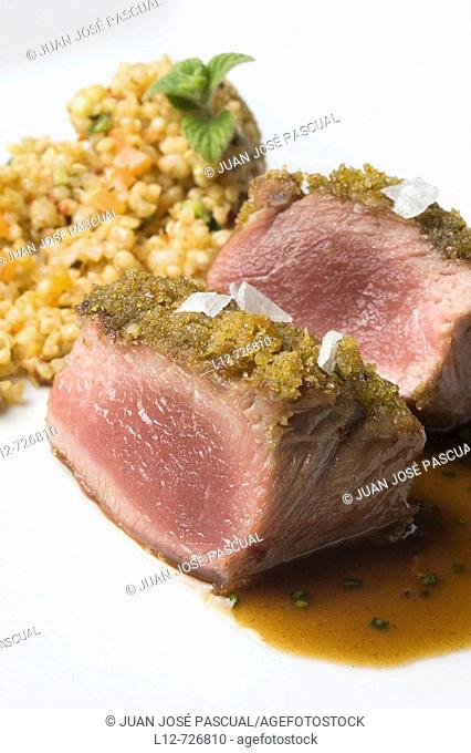 Lamb loin with aromatic herbs and grain couscous at restaurant A Estacion by chefs  Xoan Crujeiras and Beatriz Sotelo, Cambre
