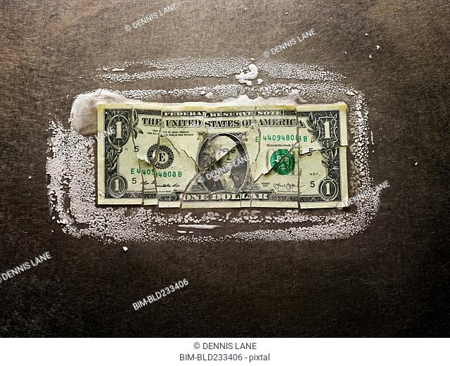 Frozen broken dollar bill