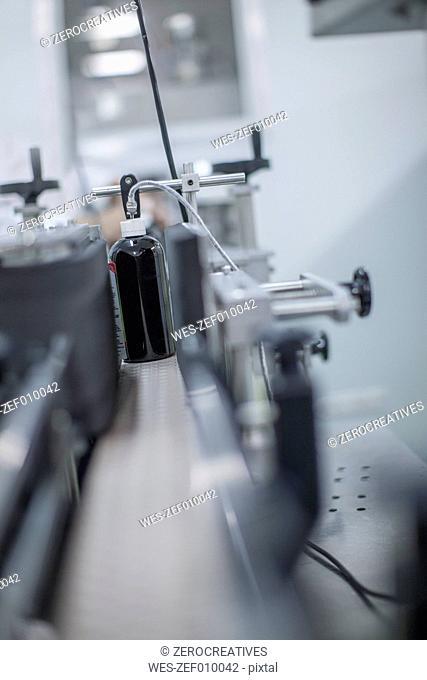 Medicinal bottle on conveyor belt