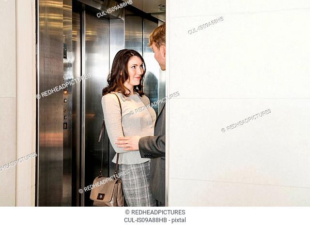 Young couple in elevator