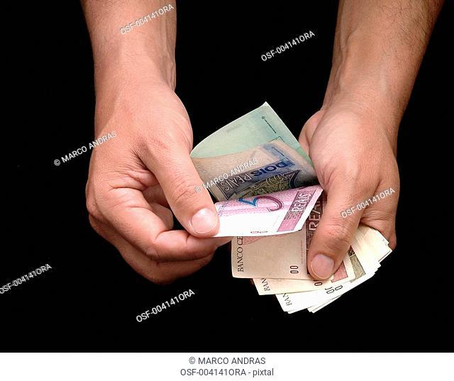 man counting bills money