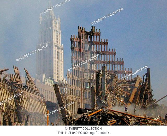 Woolworth Building rises behind the rubble of the collapsed North Tower of the WTC, Sept. 16, 2001. World Trade Center, New York City, after September 11