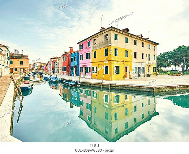 Traditional multi colored houses on canal waterfront, Burano, Venice, Italy