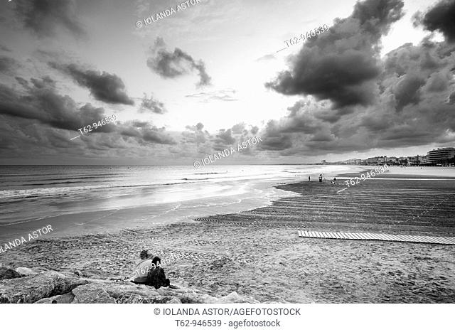 Panoramic view of a deserted beach in stormy afternoon  Black and white