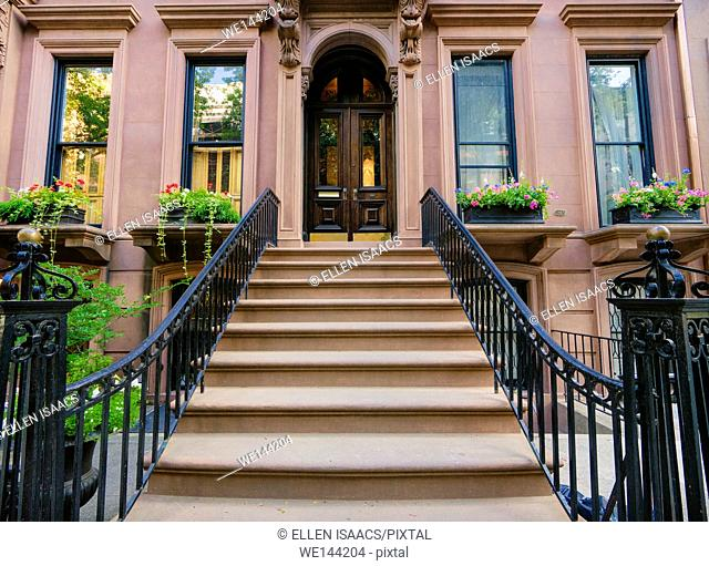 Lovely brownstone building with wrought iron bannister in Brooklyn Heights, New York