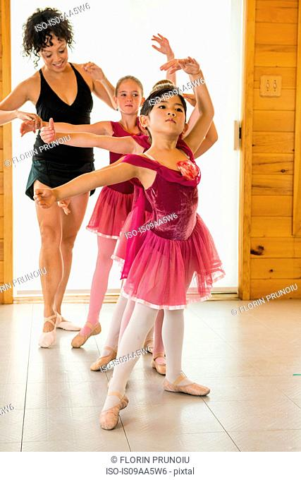 Ballerinas practising with ballet teacher