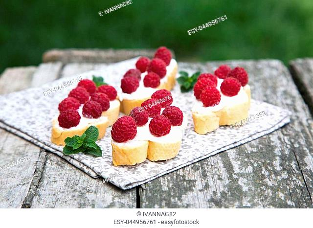 bruschetta with cottage cheese and fresh raspberries. fruit sandwich