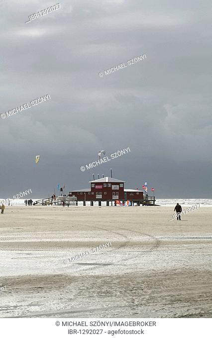 Aquatic Center X-H20 with kite surfers during a storm on the North Sea, St. Peter Ording, Schleswig-Holstein, Germany, Europe