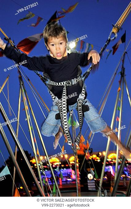 BOY JUMPING IN ELASTIC