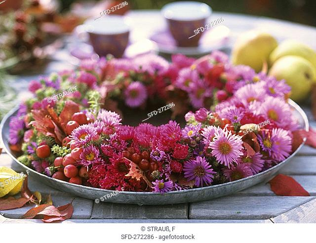 Wreath of different asters and ornamental apples