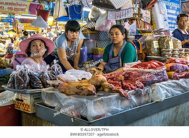 marketwoman sells meat at a market near Lampang, Thailand