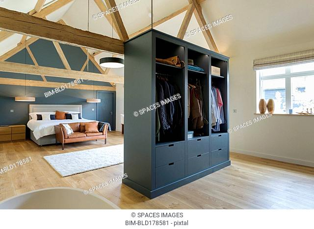 Wardrobe and bed in modern bedroom