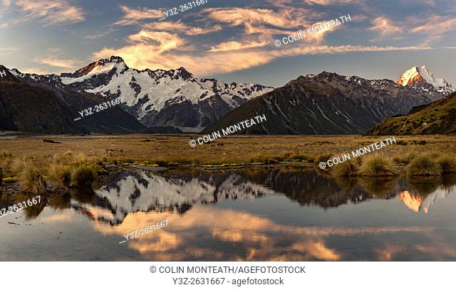 High wind cloud at sunset, Mounts Sefton ( left) & Aoraki / Mount Cook, Tasman glacier valley, Aoraki / Mount Cook National Park